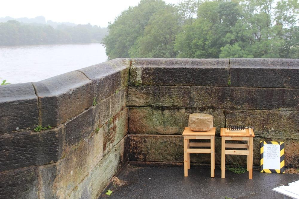 Coin stamping equipment by the side of the River Ribble.