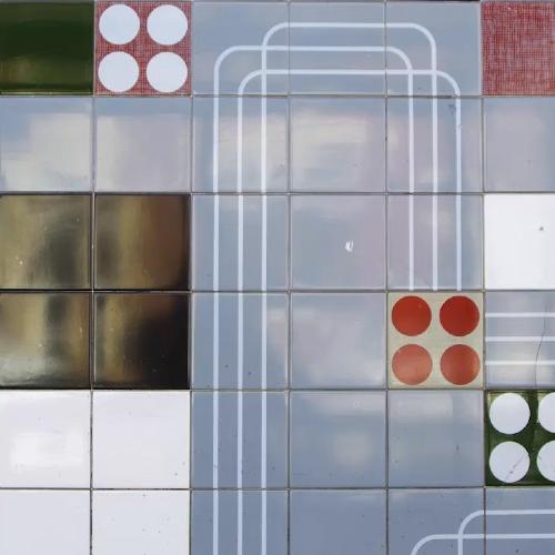Close up of black, grey and red patterned tiles.