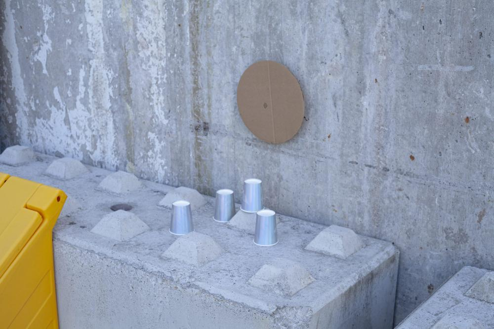 Abstract street creation using a cardboard circle and silver cups