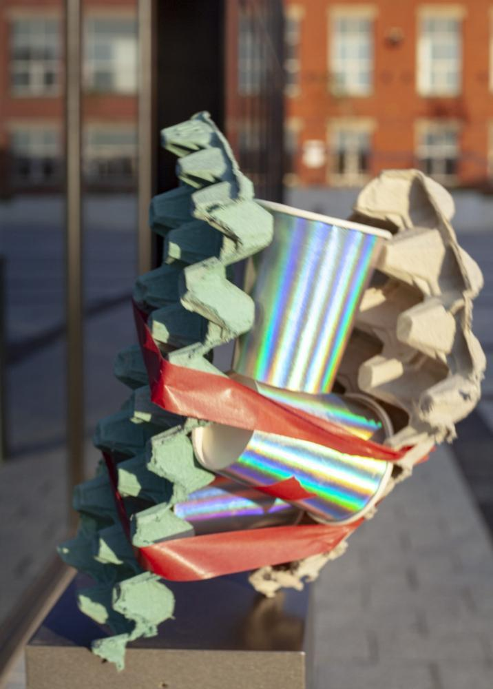Abstract street creation using egg cups, silver cups and red tape