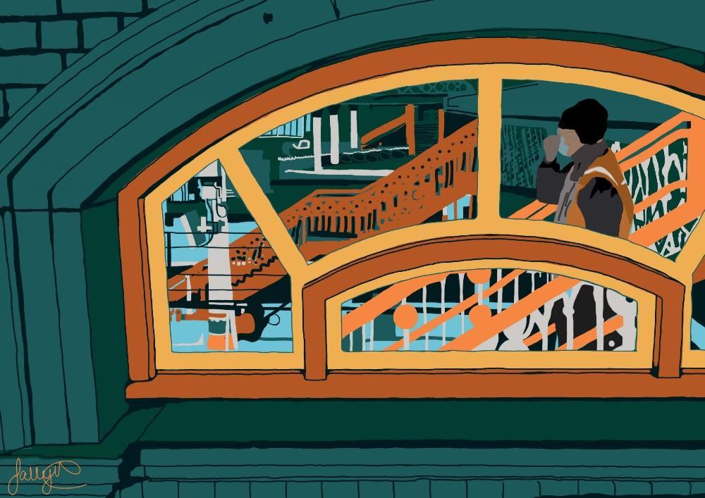Bold artwork of a rail worker through a window of Preston train station