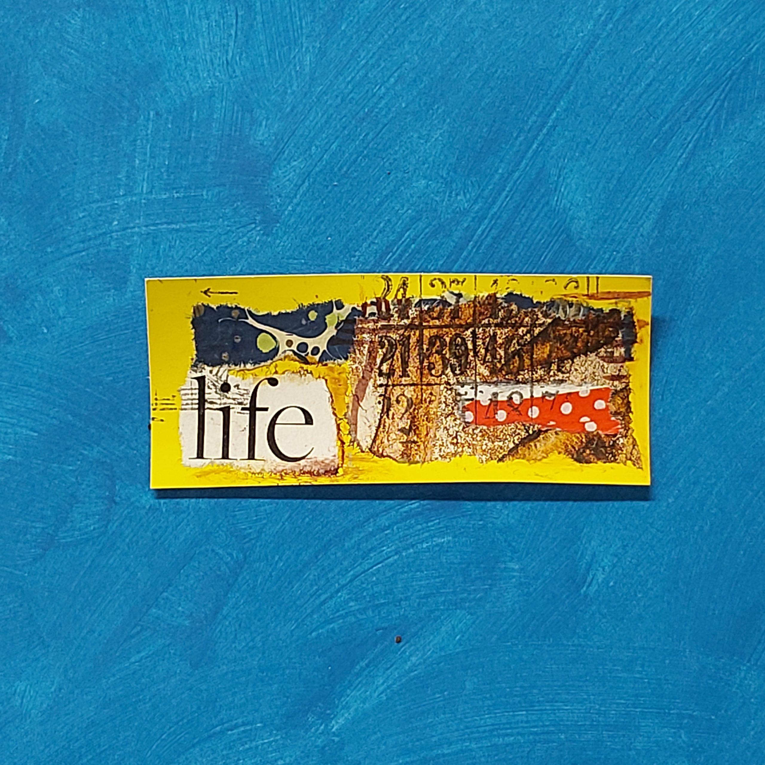 """Image 4: Abstract art on yellow card with words """"Life""""."""