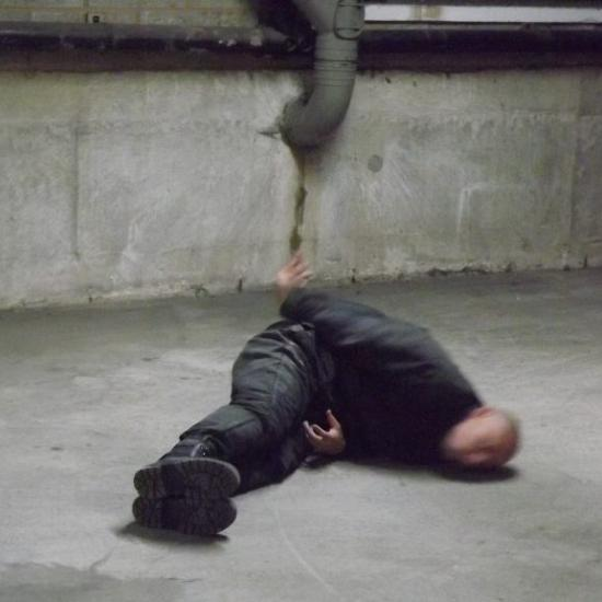Photograph of man on street floor as part of Tom Heyes commission.