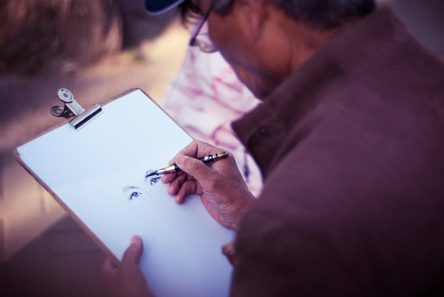 A man drawing